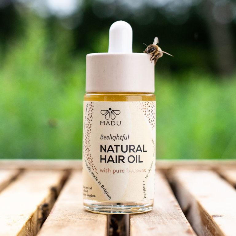 huile pour cheveux MADU avec une abeille